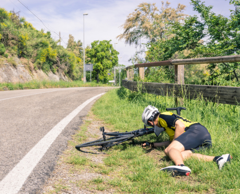 Bicycle accident on the road - Biker in trouble