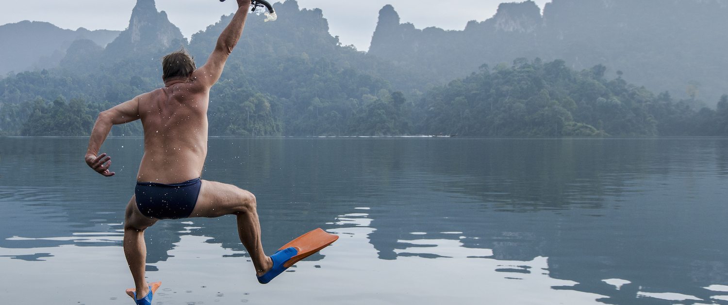 man with joint replacement jumping into lake